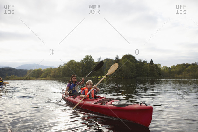 Family canoeing on lake, Staffelsee, Murnau, Oberbayern, Bavaria, Germany