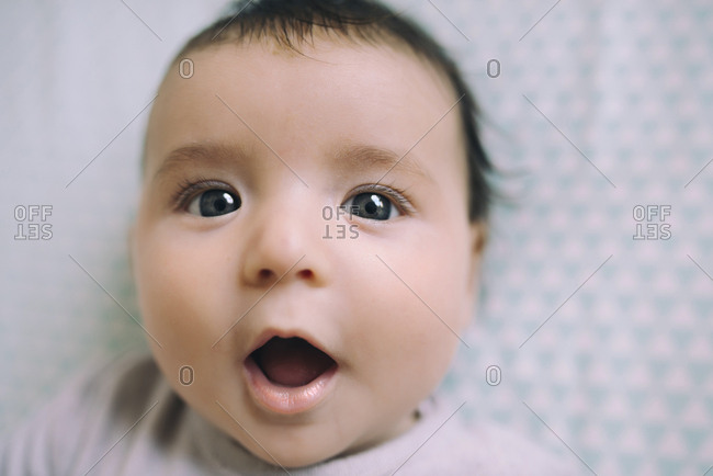 Surprised baby girl with open mouth