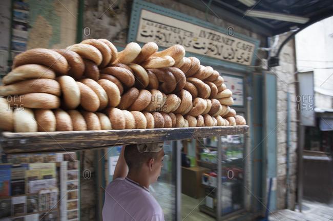 Jerusalem, Israel - June 13, 2011: Man delivering fresh bread