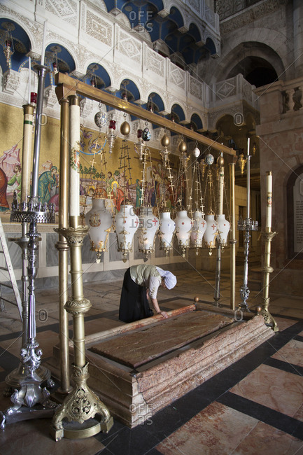 Jerusalem, Israel - June 13, 2011: Stone of anointing in Church of Holy Sepulchre