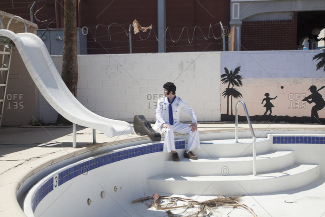 Jerusalem, Israel - April 25, 2011: Elvis impersonator by empty pool