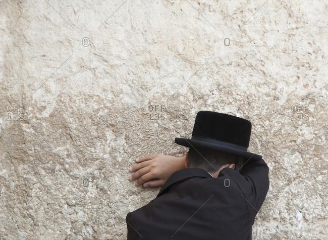 Orthodox Jewish man praying at Wailing Wall