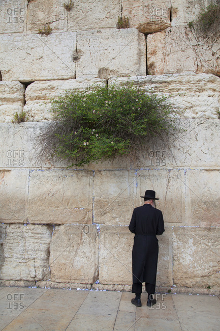 Jewish man praying at Wailing Wall