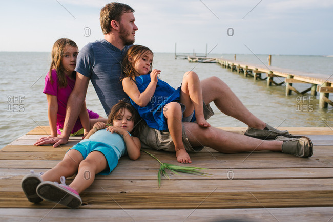 Dad with three girls on dock