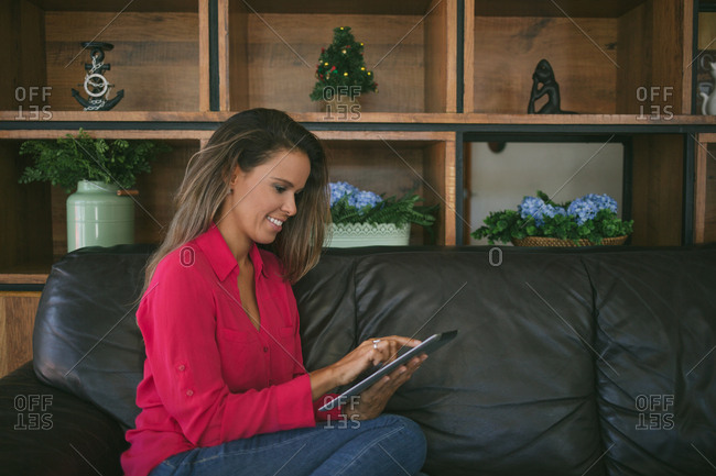 Woman on her couch with tablet