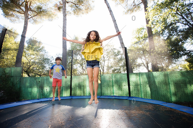 Girl and boy on trampoline