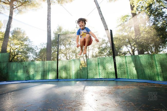Boy midair on trampoline