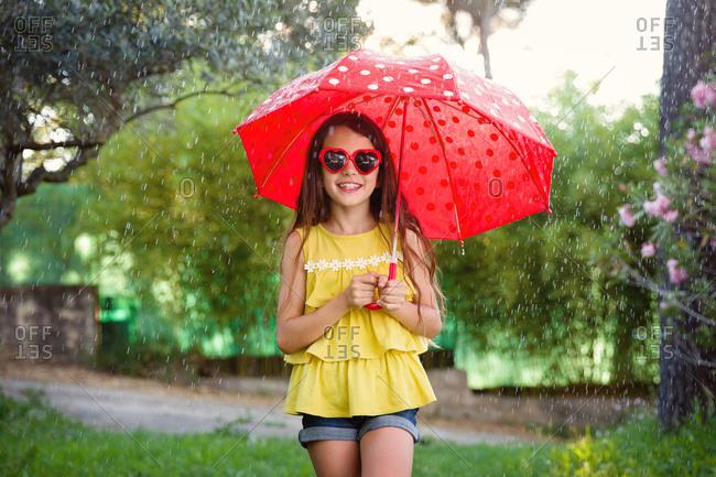 Girl in umbrella and sunglasses