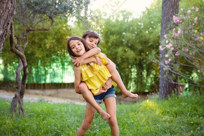 Girl carrying brother on her back
