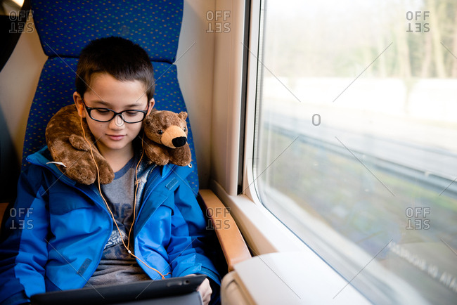Boy using device on a train