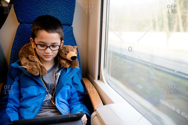 Boy using device on a train