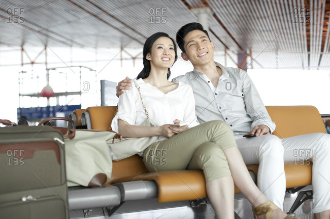 Young couple waiting in airport lounge
