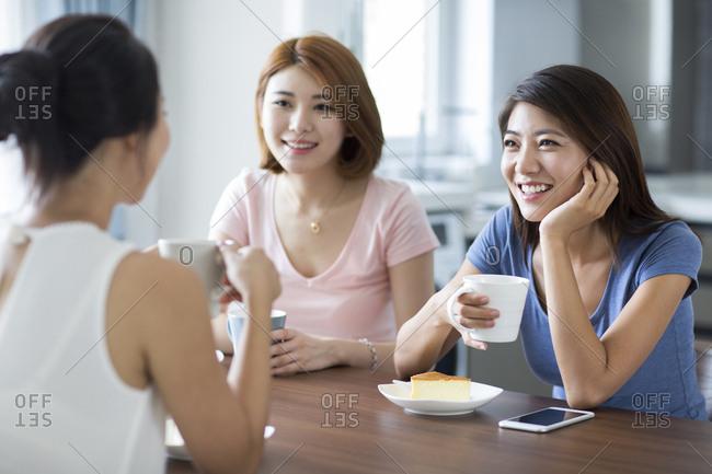 Best female friends having breakfast at home