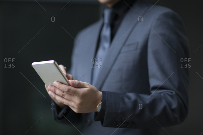 Mid adult businessman using smart phone