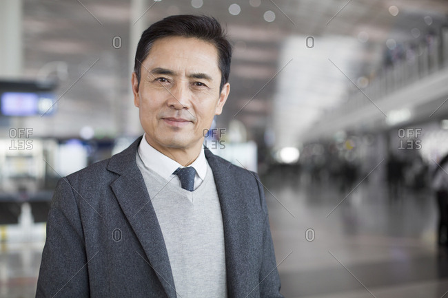 Businessman in airport lobby