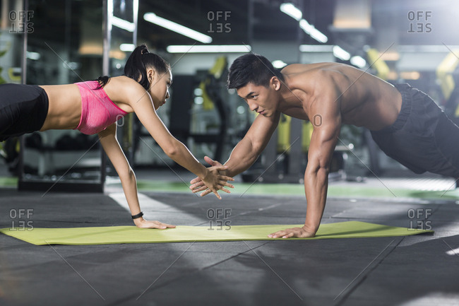 Young couple exercising at gym