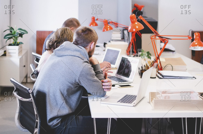 Business people working at desk in creative office