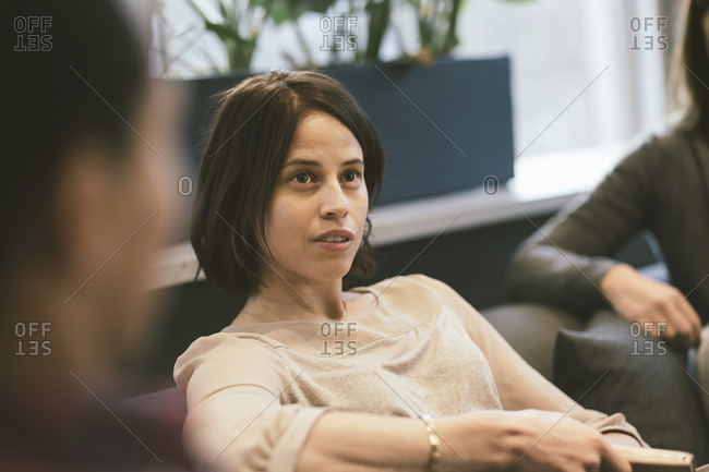 Serious businesswoman listening in meeting at office