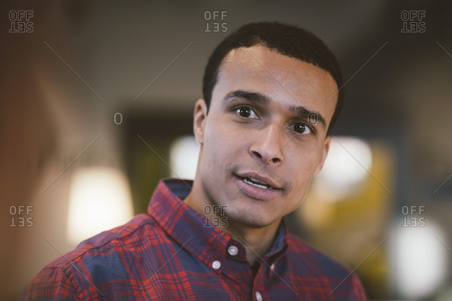 Smiling businessman looking away at office