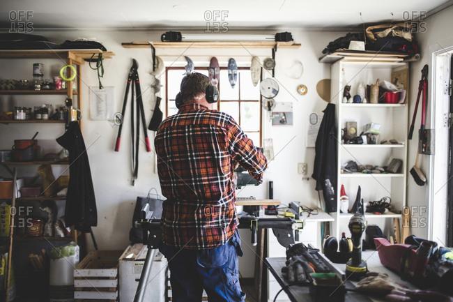 Rear view of senior man working in workshop