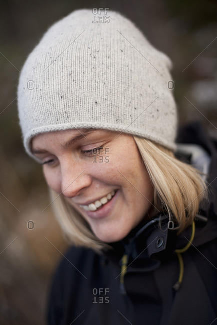 Close-up of happy mature woman wearing knit hat