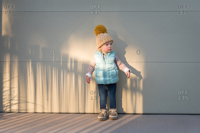 Girl in sunlight wearing cold weather clothes