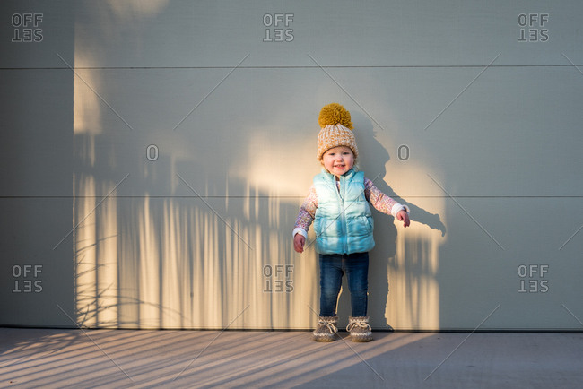Toddler in sunlight in cold weather clothes