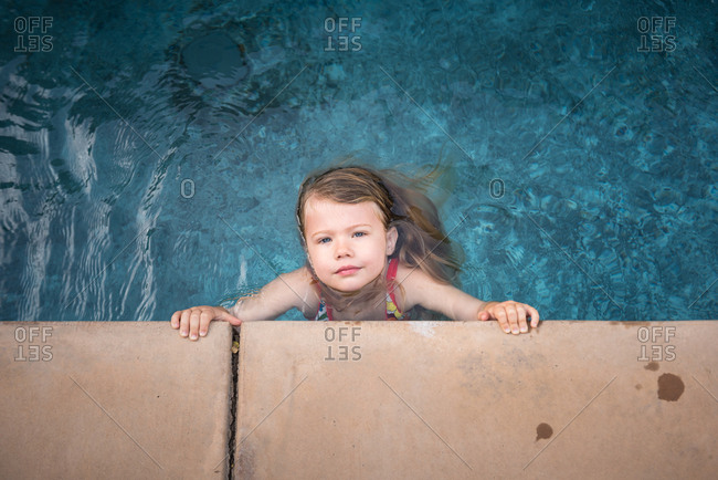 Girl looking up from pool water