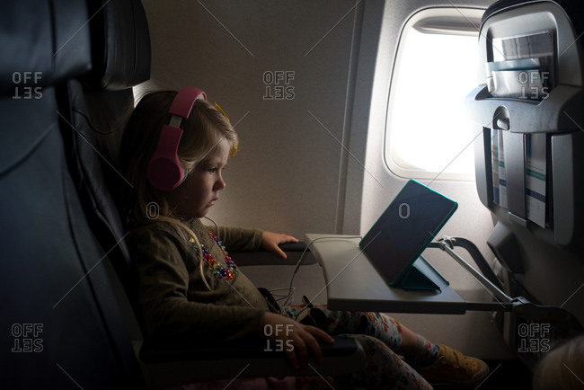 Girl on flight using a tablet