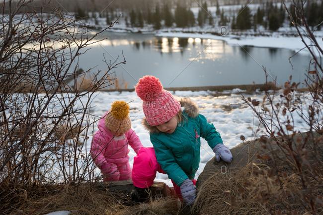 Girls climbing in rural area in winter