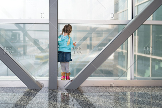 Girl looking out a modern building