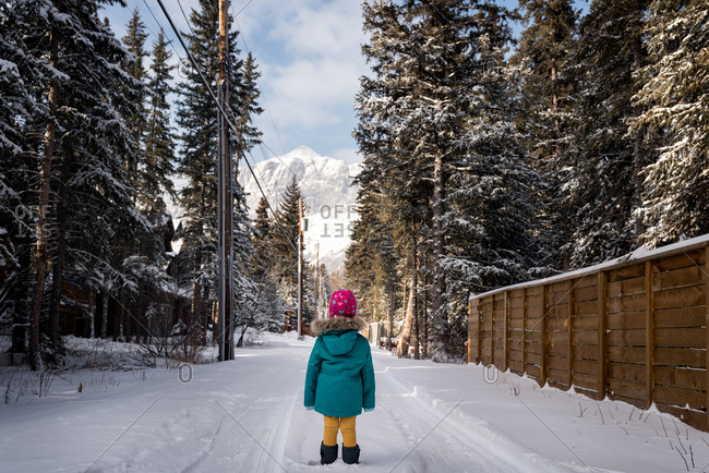 Girl standing on snowy road