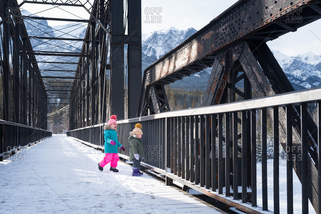 Girls on trestle in snowy mountains