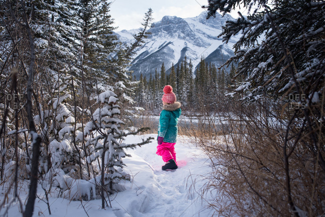 Girl looking at snowy mountain view