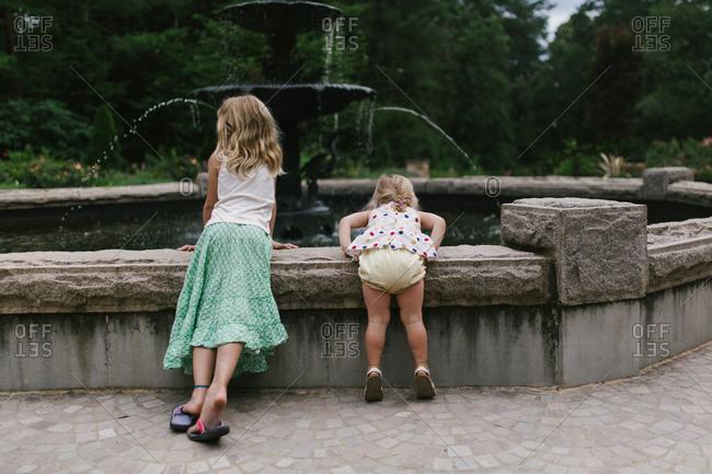 Girls by fountain in garden