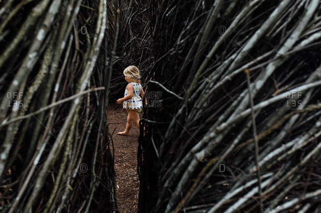 Toddler among stick structures