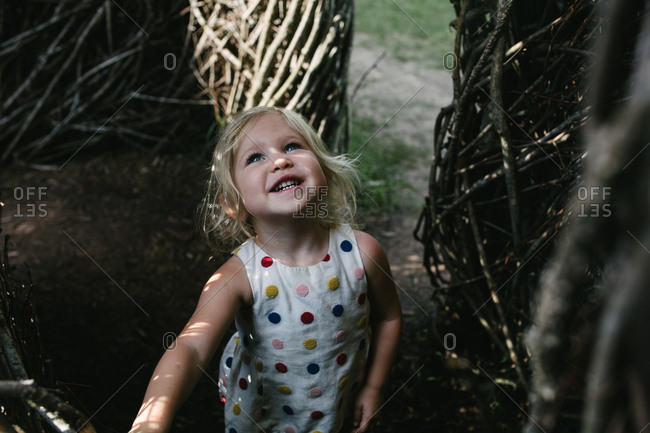 Toddler standing in a stick structure