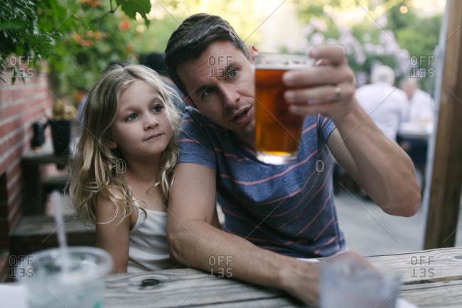 Dad looking at beer with girl
