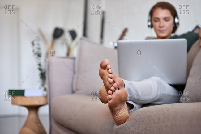 Woman at home watching movies on a laptop