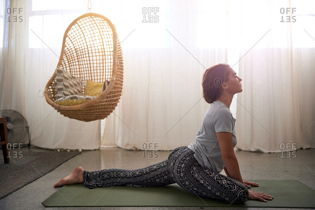 Woman focusing on stretching in pigeon pose