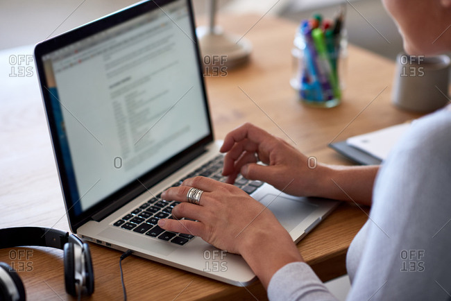 Woman's hands typing on keyboard