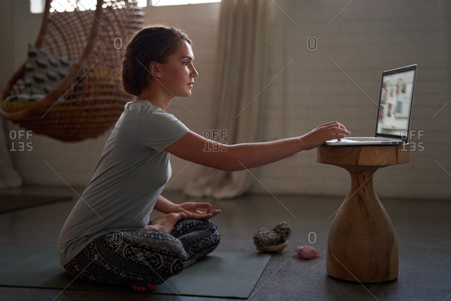 Woman getting ready to start yoga session at home