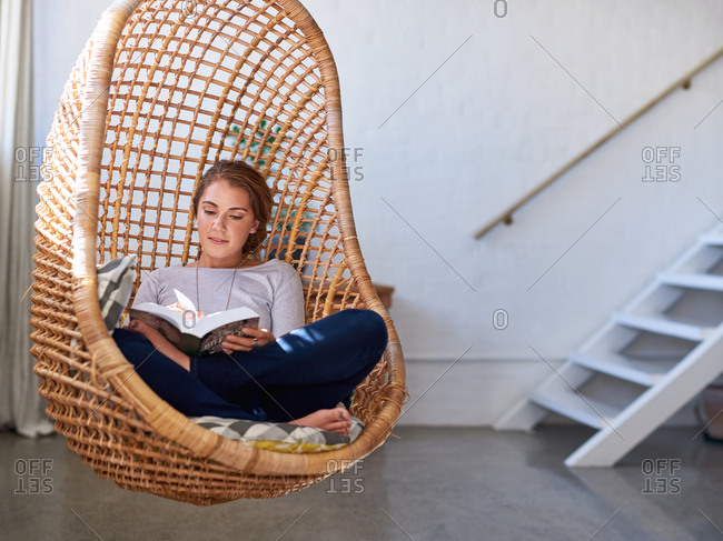 Brunette woman using technology sitting on at home