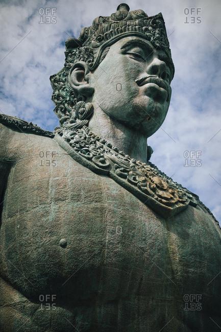 A large stone statue of Wisnu at GWK Cultural Park in Bali, Indonesia.