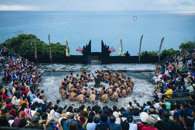 4/4/17: A traditional kecak performance overlooking the ocean at dusk at Ulawatu Temple in Bali, Indonesia.