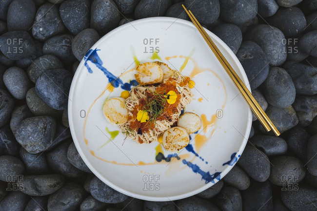 Scallop somen with fish roe, ebi, and salted egg yolk sauce in Singapore.