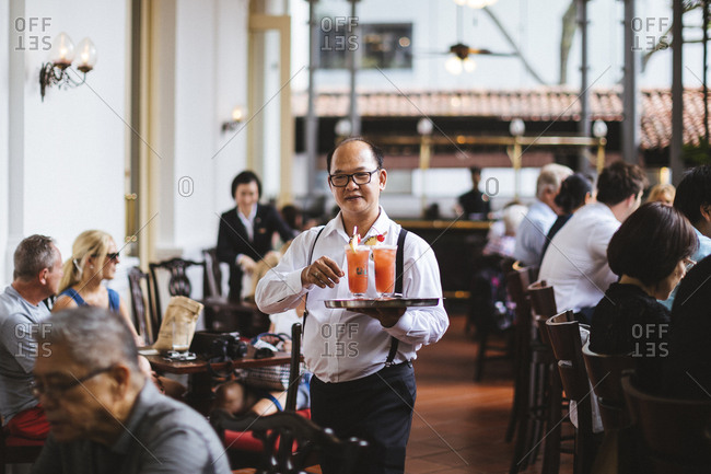 2/15/17: A waiter serves Singapore Slings at the Raffles Hotel in Singapore.