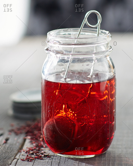 Hibiscus tea brewing in glass jar
