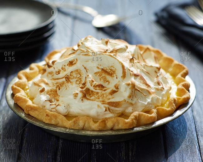 Lemon meringue pie on wooden table
