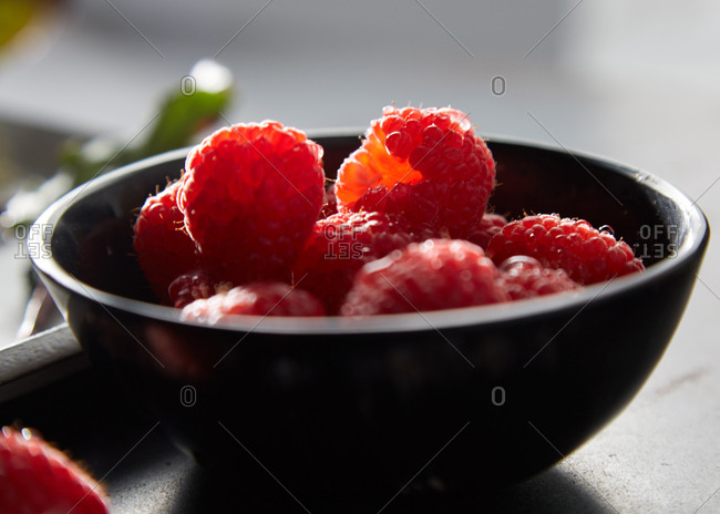 Close-up of a small bowl of fresh raspberries